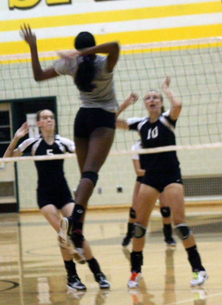 Senior Danielle Cuttino goes up for a spike against Speedway in the preseason scrimmage.