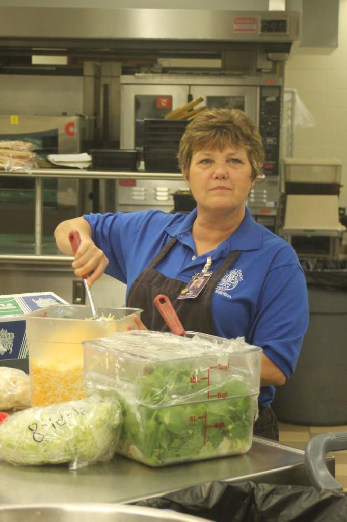 Cafeteria manager Tammy Batson prepares lunch. Batson oversees the staff that prepares breakfast and lunch daily.
