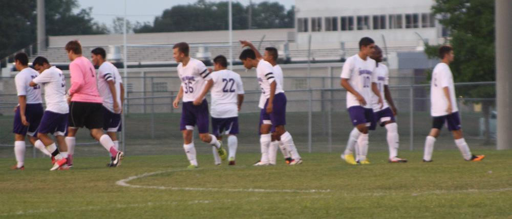 Members of the boys soccer team walk away after scoring a goal in Thursdays 6-1 win over Lawrence Central.