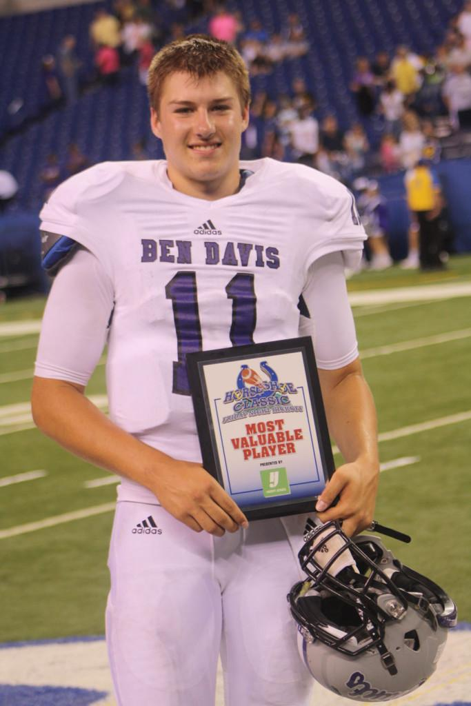 Junior Kyle Castner poses with his MVP honor in Friday's opener at Lucas Oil.