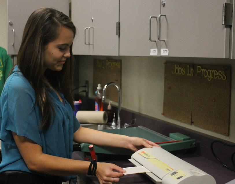 Students do everything from laminating copies to making business cards in Debbie Diss' business tech lab.