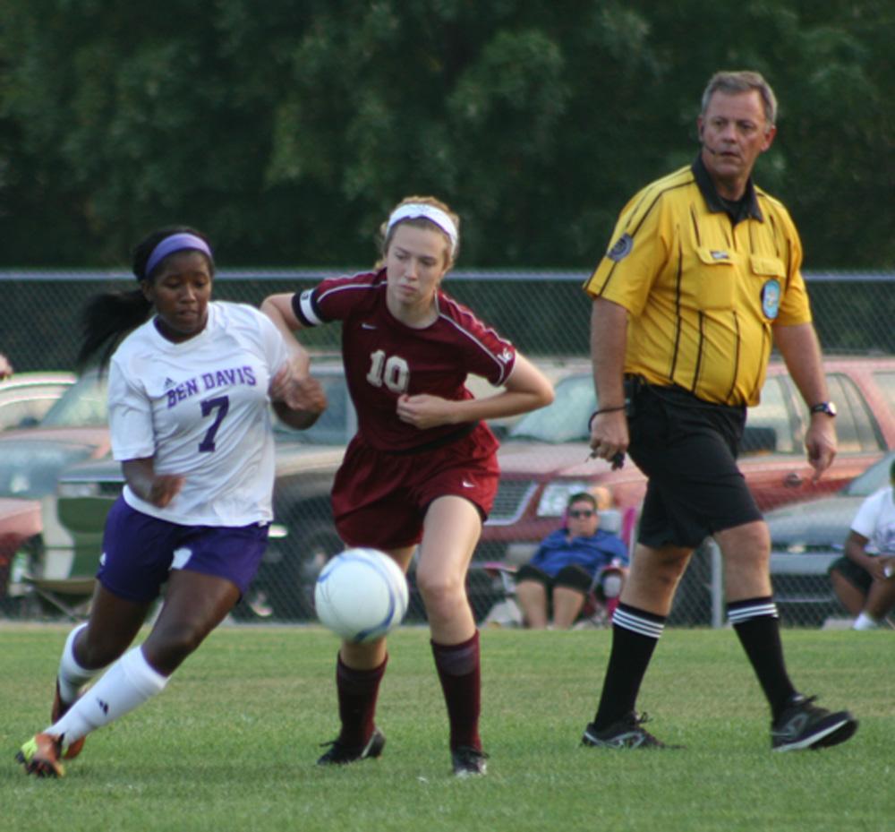 Senior Mariah Allen-Harris battles a Lawrence Central defender Wednesday night.