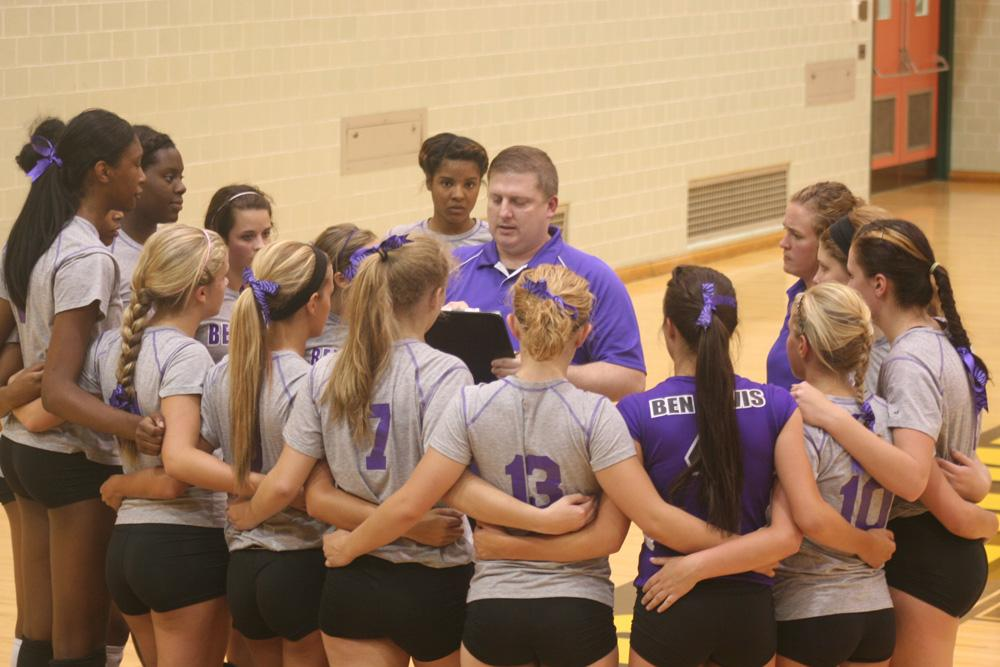 Coach Carl Lucas talks to the girls volleyball team prior to the start of Wednesday's scrimmage at Speedway.