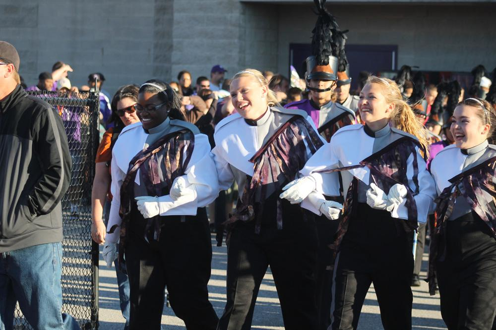 The drumn majors lead the band on to the field prior to the game.