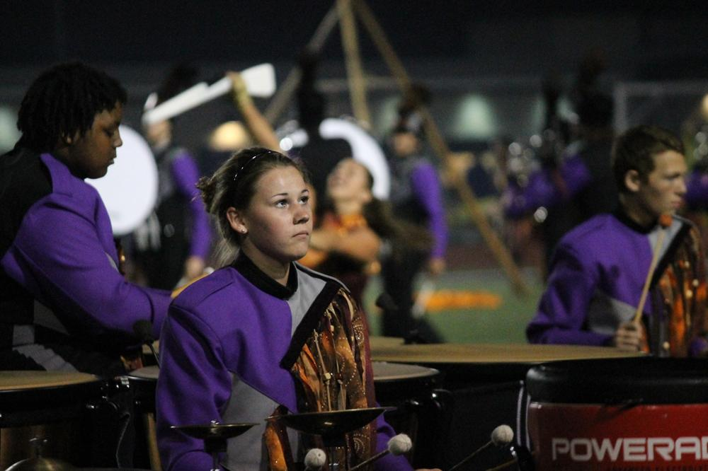 Senior Lauren Soller performs with the marching band at half time.