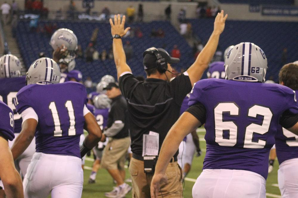 Assistant Patrick Shanley raises his arms high as the Giants celebrate a 49-48 overtime win over Pike.