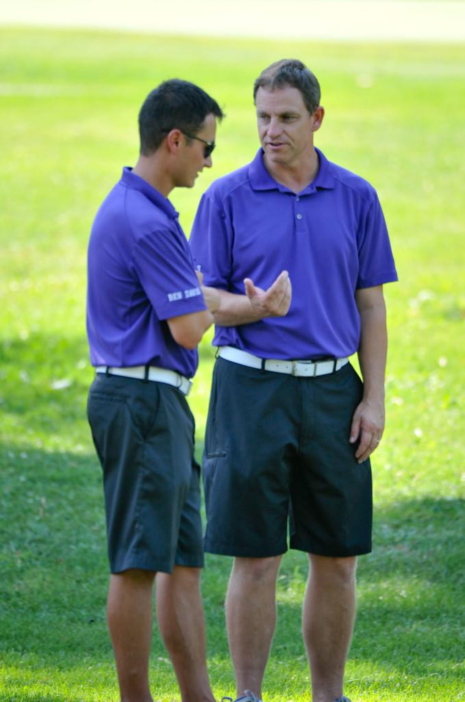 Coach Dave Patz (right) talks with assistant coach Bobby Chin before a match at South Grove this year.