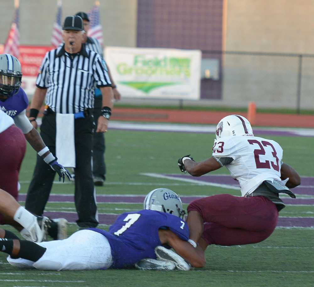 Senior Antwone Crawford makes a tackle to stop LC runner