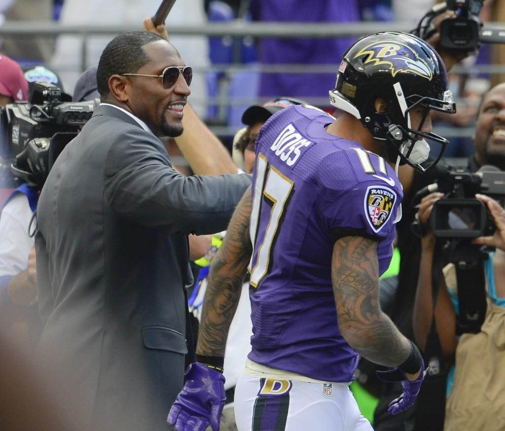 Former Baltimore Ravens star Ray Lewis jokes with Ben Davis graduate Tandon Doss Sunday afternoon after Doss scored his second NFL touchdown.