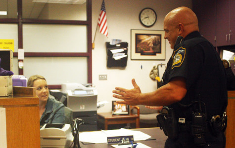 Officer Jeff McCleerey talks with Meaghan Molsberry in the deans office,.