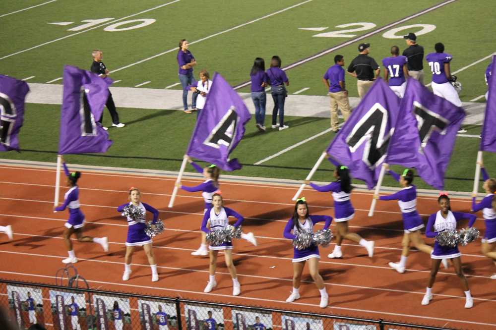 Cheerleaders run the flags after Giants score touchdown