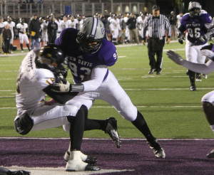 Senior Albert Williams sacks the Avon quarterback during the third quarter of a 35-14 win.