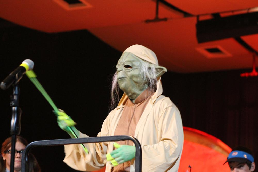 Orchestra+director+Amy+Noble+dresses+up+as+Yoda+from+Star+Wars+during+Wednesday%27s+annual+Halloween+concert.