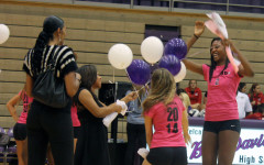 Danielle Cuttino (far right) enjoys a fun moment during Senior Night festivities. She is one of five seniors on this year's volleyball team.