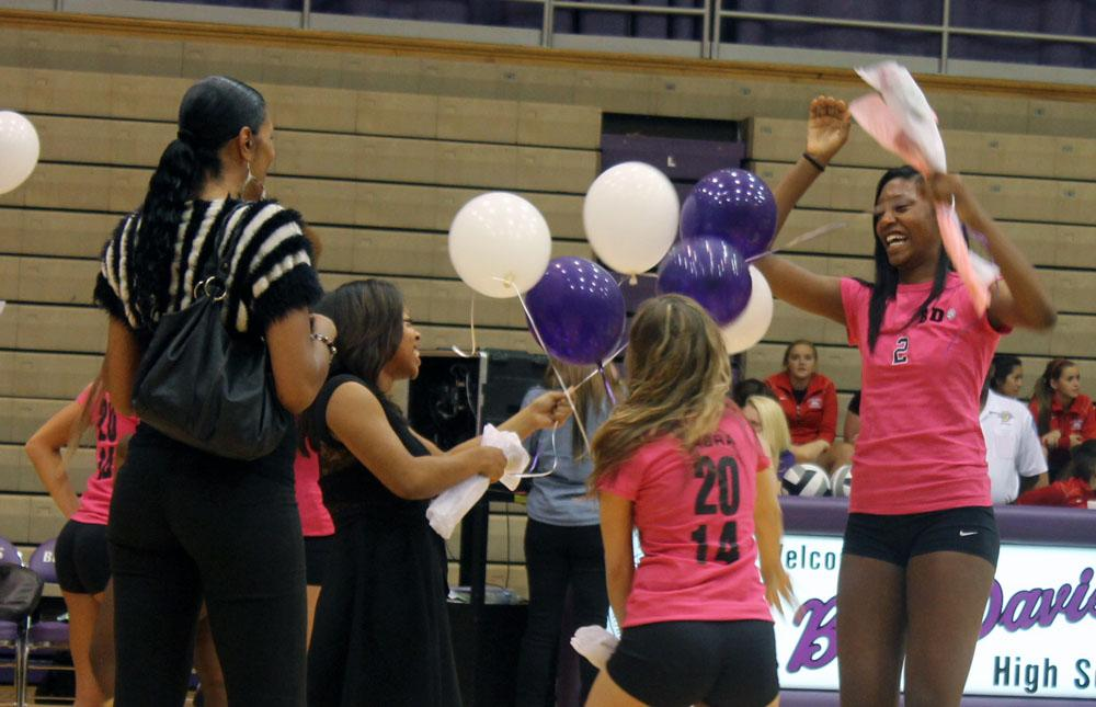 Danielle Cuttino (far right) enjoys a fun moment during Senior Night festivities. She is one of five seniors on this years volleyball team.