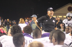 Coach Mike Kirschner addresses the football team following a 37-20 win over No. 1 Center Grove.