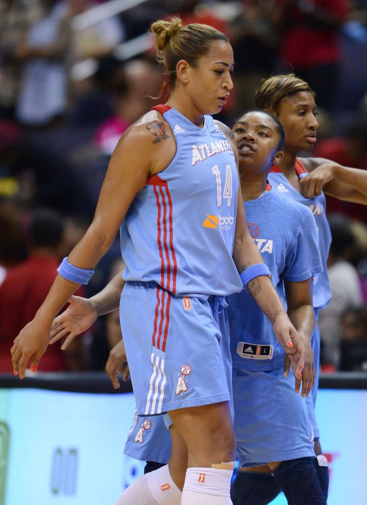 Atlanta Dream guard Alex Bentley (2) encourages teammate Erika de Souza (14) during a timeout in a WNBA playoff game. Bentley led the Giants to the 2009 National Championship and an undefeated season.