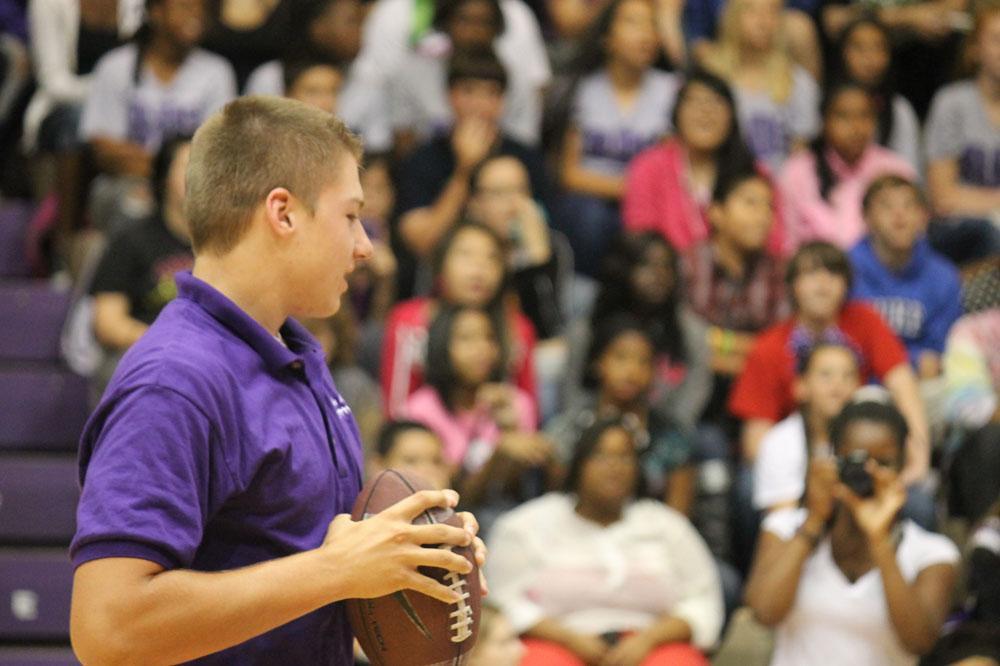 Junior quarterback Kyle Castner plays a football tossing game.