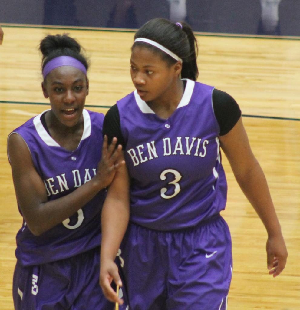 Senior Leena Sibande (3) and sophomore Taylor McDaniel during Saturday's game at Brownsburg.