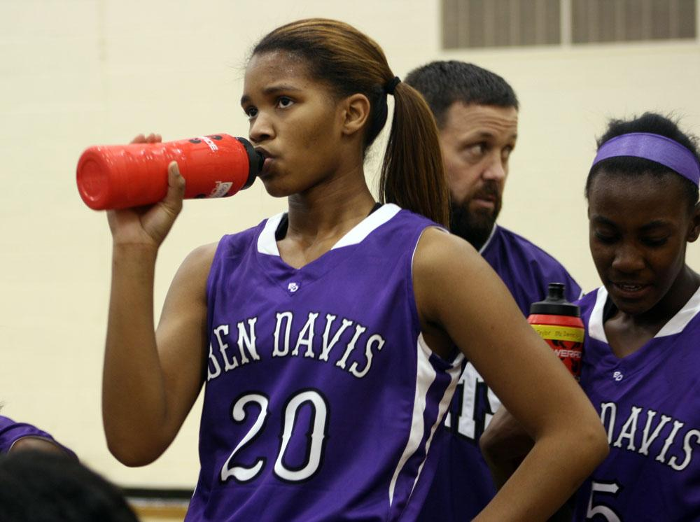 Junior Caprice Garner takes a drinkl during Thursdays scrimmage at Cathedral.