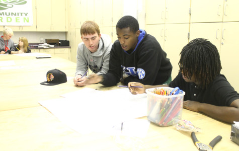 Connor Branscum, Delano Patton, and Michael Scott discuss their layout.