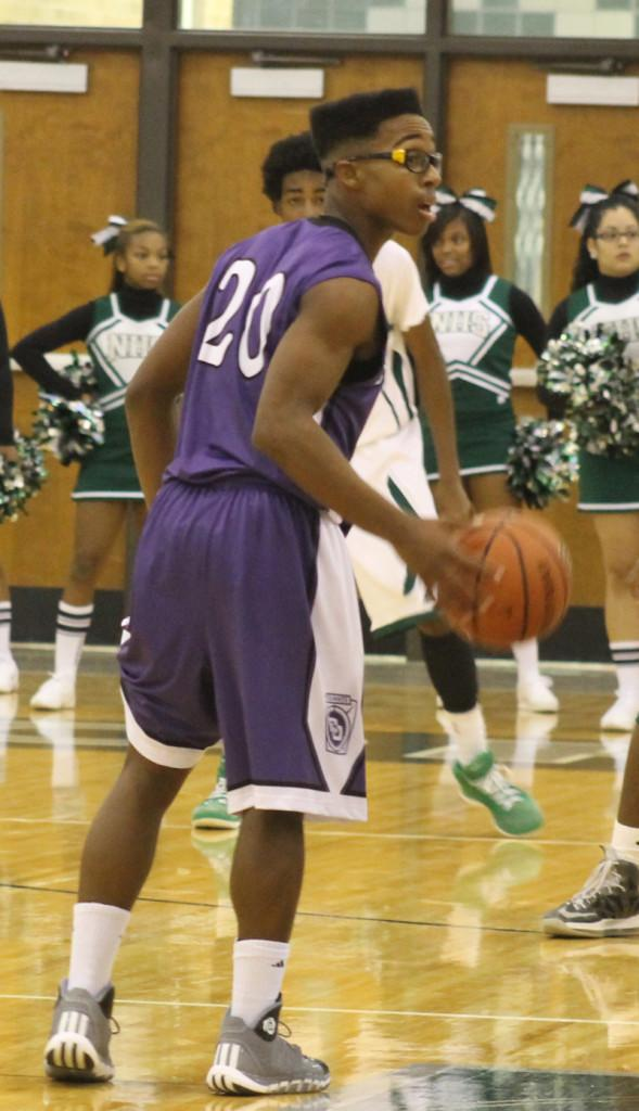 Sophomore guard Chris Evans looks for instructiions during a win at Northwest. The boys travel to Pike Friday and host Southport Saturday.