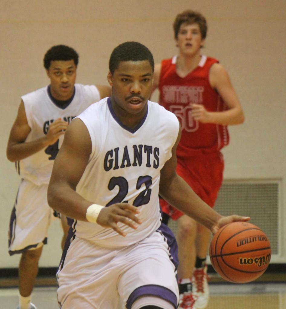 Senior Michael Beaty brings the ball up court against Southport.