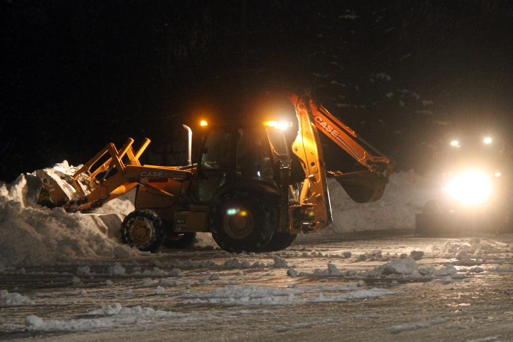 Crews+move+snow+in+the+north+parking+lot+as+Wayne+Township+schools+reopen+today.+Students+are+expected+to+return+on+Monday.