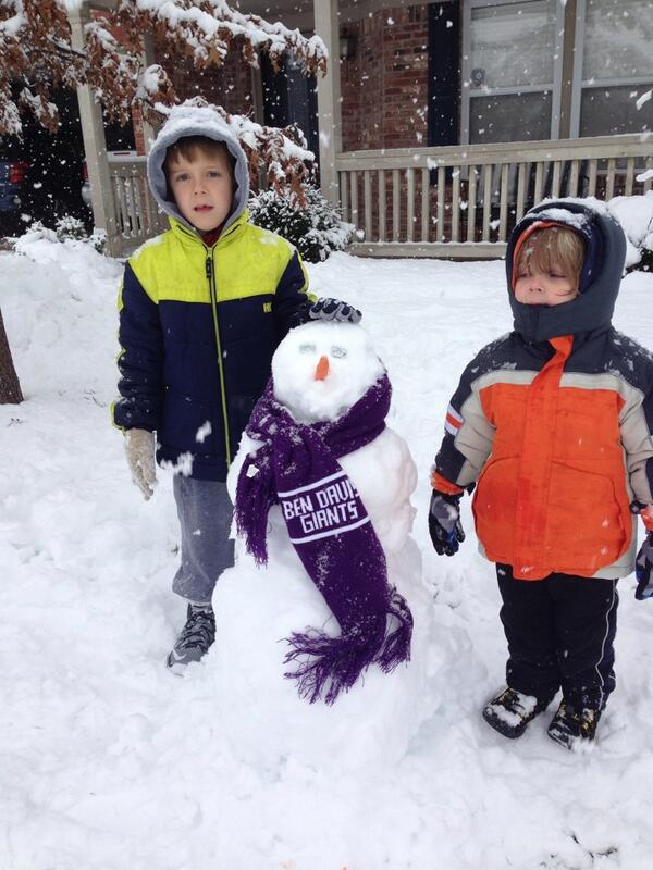 Social studies department chairman Shannon Singleton builds a snow man adorned with a Giants scarf.