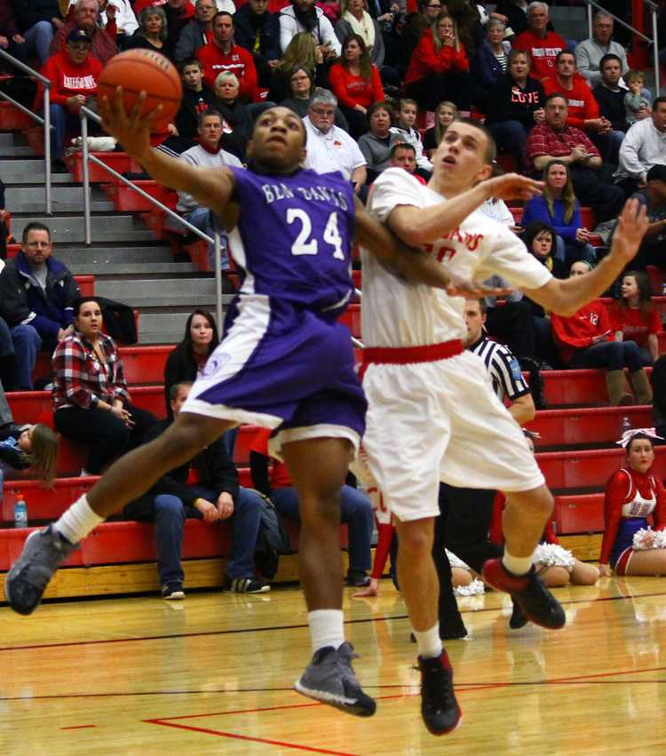 Junior Deshon Tate goes up for two points against Center Grove.