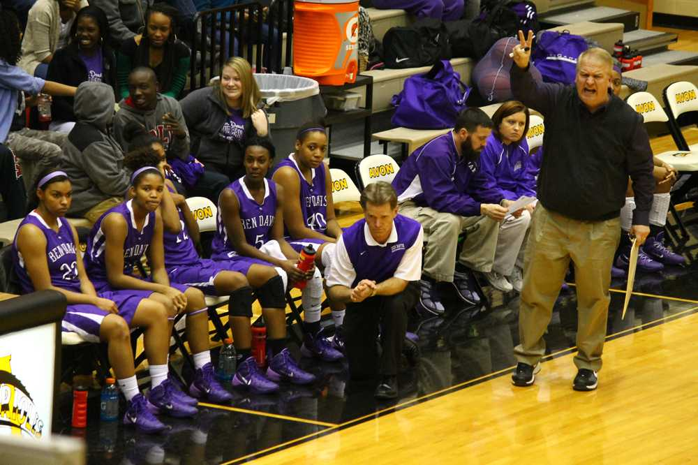 Assistant coach Brad Dickison calls for a play at Avon Thursday night.