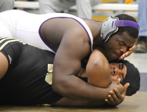 Junior heavyweight wrestler Norman Oglesby pins an opponent earlier this season. Olgesby is one of five wrestlers competing at the Evansville semistate this weekend.