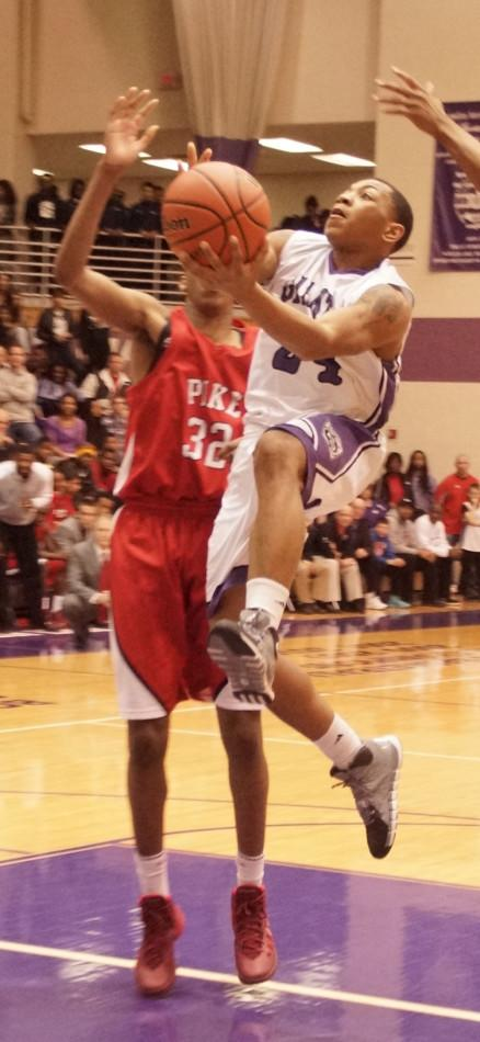 Junior Deshon Tate goes for two points as the Giants season came to an end Friday night.