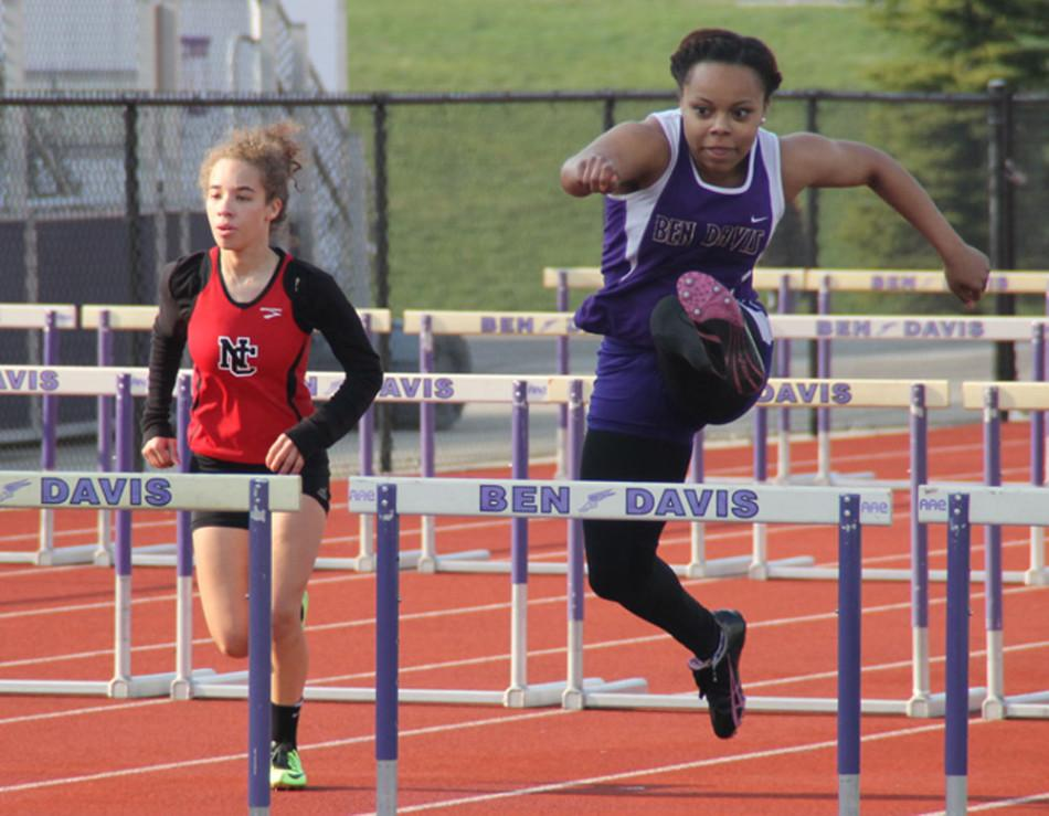 Senior++Azaria+Joseph+clears+a+hurdle+during+Tuesday%27s+meet+against+Lawrence+North+and+North+Central.+The+Giants+finished+seond+in+the+meet.