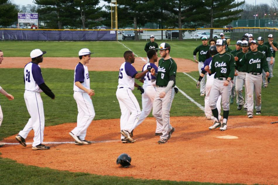 The Giants congratulate Lawrence North after a thrilling 10-9 win.