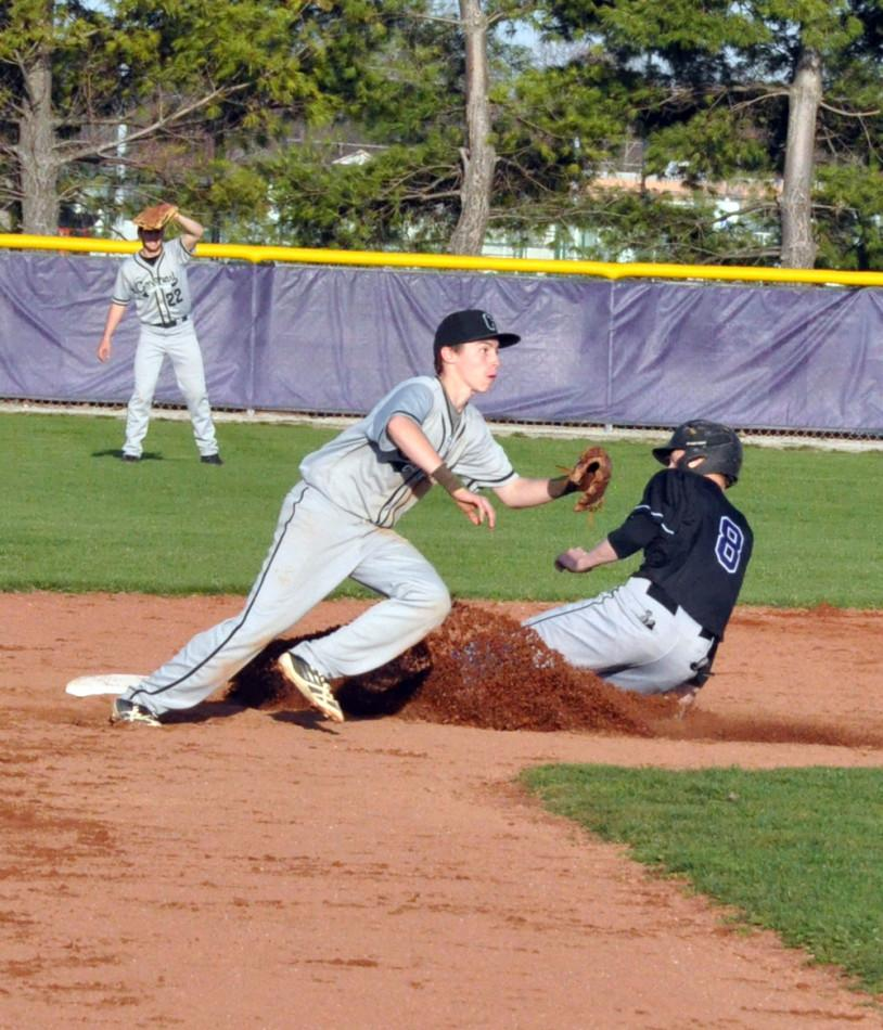 Senior Cody Turper is safe at second base.