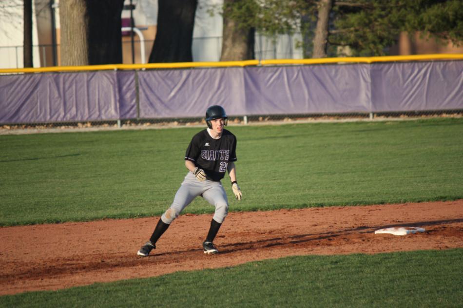 Junior jake Stewart rounds second base.