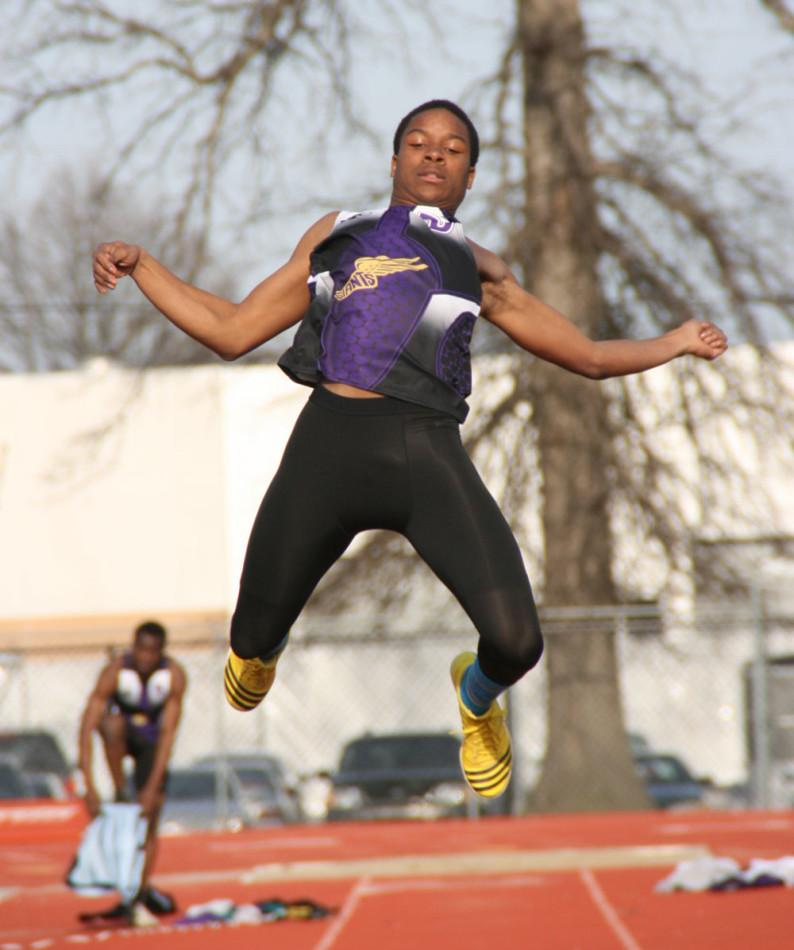 Senior Jaymin Miles flies through the air during Wednesday's meet against Warren Central. The Giants host the BD Relays Saturday at 11 a.m.