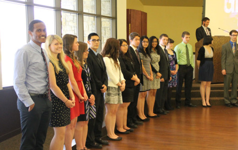 Top 30 students wait in alphabetical order to be called up and for their high school participation, high school achievements and future college they will be attending to be announced.