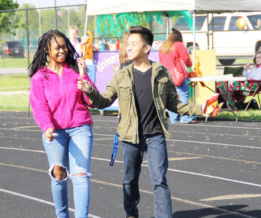 Sophomore Natalie Chidemo and junior Mark Menciano talk while taking a walk around the track.