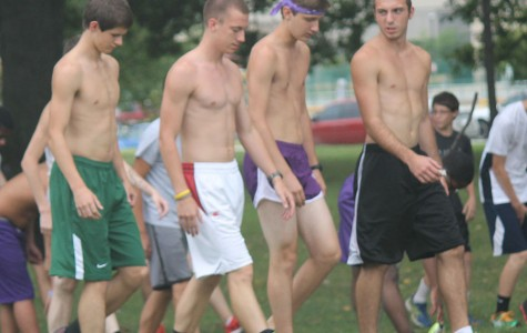 Senior Connor O'Day (white shorts) and the rest of the boys cross country team warm up during a recent practice.
