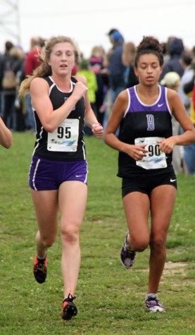 Senior Connie Brahm (95) runs past a Brownsburg runner at the Ben Davis Invitational.