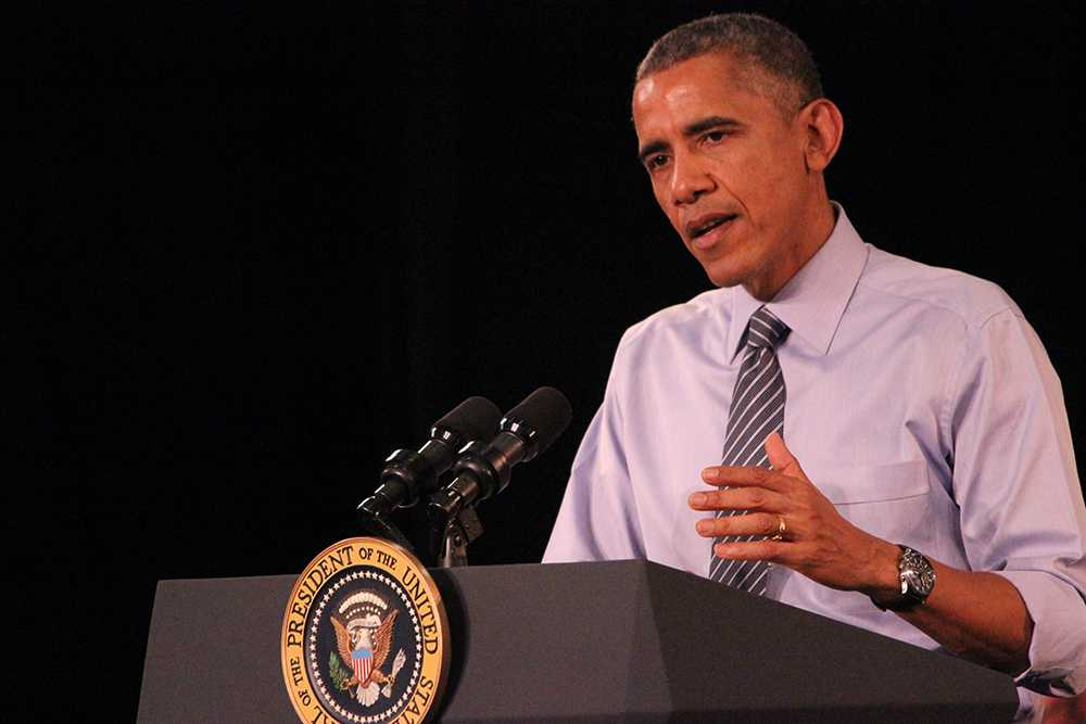 President Barack Obama addresses a town hall meeting Friday at Ivy Tech near downtown Indianapolis.