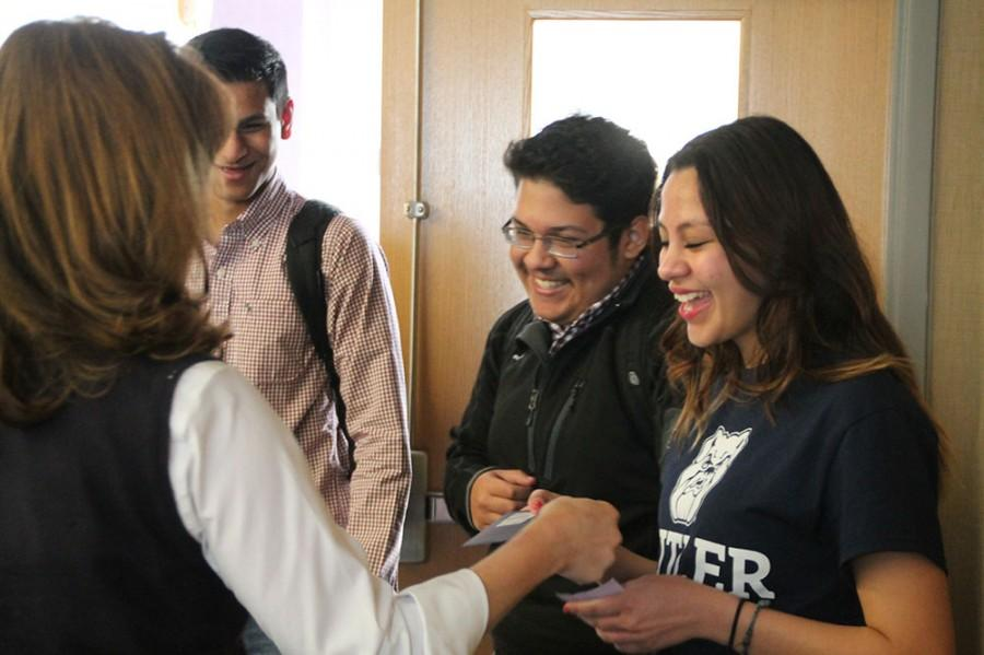 Senior Nicolasita Salas is surprised by Butler University officials in the Principal's Conference Room this morning.