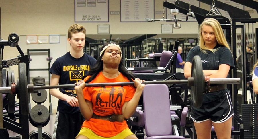 Senior Zakia Self lifts weights during a weight class this week. A report last week listed Indianapolis as the least fit city among the top 50 cities in the country. Many PE teachers believe more emphasis needs to be placed on fitness classes at the high school level.