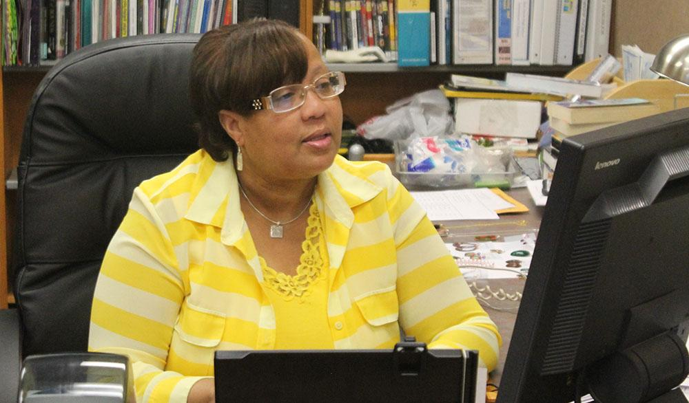 Media center specialist Kathy Hicks-Brooks looks at her schedule. The media center is open for students before school.