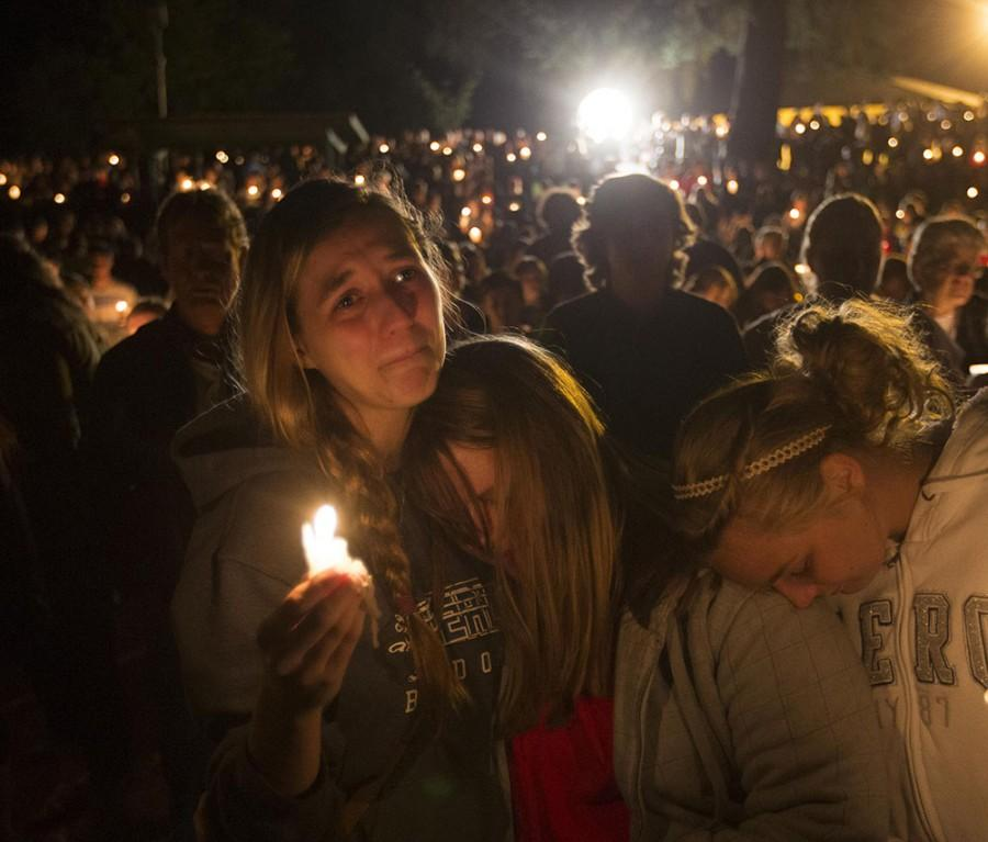 A group of young women console each other during a vigil on Oct. 1, 2015 in Roseburg, Ore. after a shooter opened fire at the Umpqua Community College, killing several. (Chris Pietsch/The Register-Guard/Zuma Press/TNS)