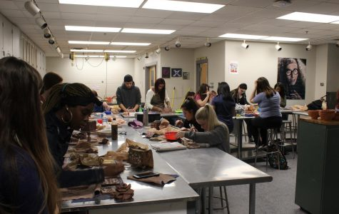 Students in Cara Owens' art class work on projects.