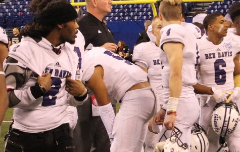 New football coach Jason Simmons helps organize the after-game festivities at the 2017 state championship in Lucas Oil. Simmons was the president of the Indiana Football Coaches Association and was hired on March 19 to take over the BD program.