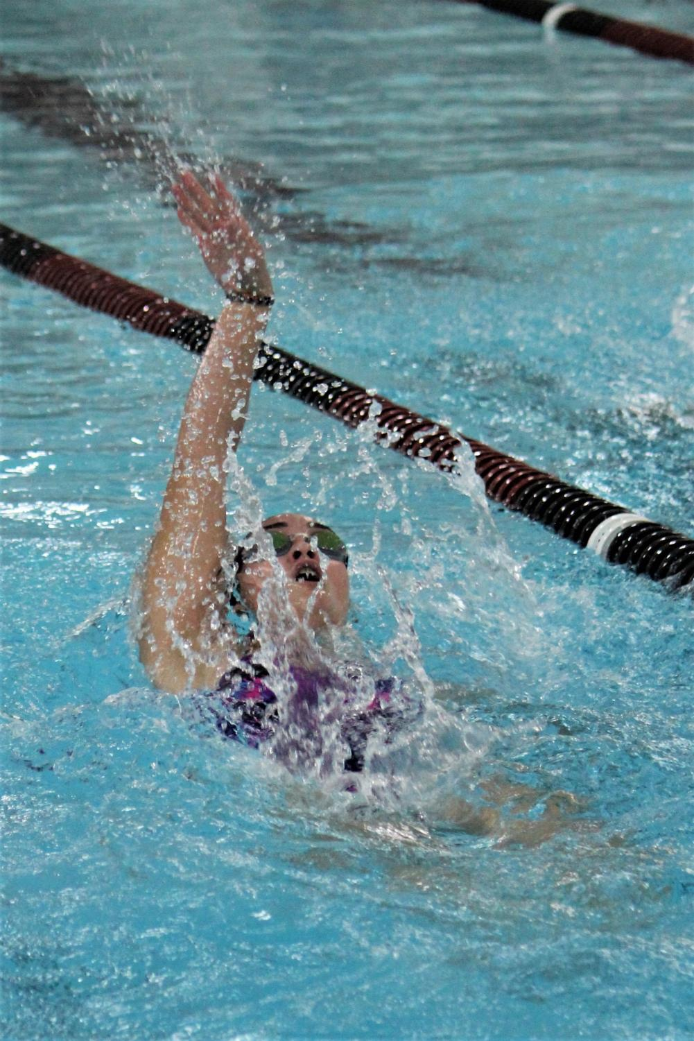 Junior Rachel Gaither swims the backstroke during a recent meet.